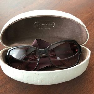 Coach sunglasses with case and fabric cleaner.
